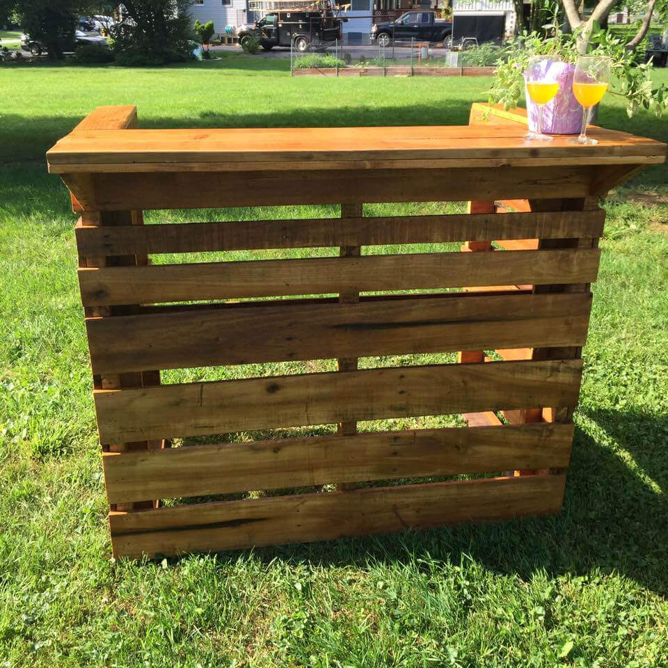 Wooden pallet bar host events for Pallet garden furniture bar