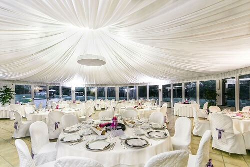 planned wedding reception table marquee and satin drapes